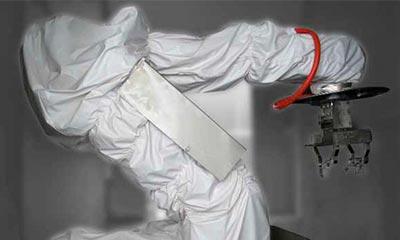 <strong>Roboterschutzhülle</strong> für ABB IRB 6640, mehrteilig, beschichtetes Gewebe mit integrierten Stanzlöchern für die Befestigung der Blechabdeckung.